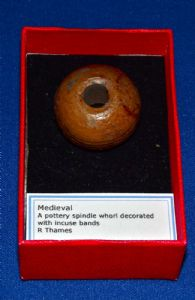 A large and attractive Medieval glazed pottery Spindle Whorl, River Thames, London. SOLD
